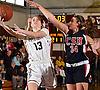 Gabrielle Zaffiro #13, North Shore junior, left, tries to drive to the net as Jen Rosenberg #34 of Cold Spring Harbor guards her during the Nassau County varsity girls basketball Class A quarterfinals at North Shore High School in Glen Head, NY on Wednesday, Feb. 22, 2017. Zaffiro recorded her 2,000th career point in the first quarter and scored 34 points in North Shore's 74-46 win.