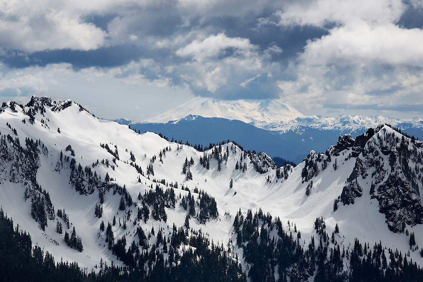 """CASCADE STORM"" -- Dense summer storm clouds roll in over the Tatoosh Range south of Mount Rainier. The low lying clouds obscure the highest reaches of nearby Mount Adams, the second tallest peak in the Cascade range."