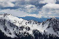 """""""CASCADE STORM"""" -- Dense summer storm clouds roll in over the Tatoosh Range south of Mount Rainier. The low lying clouds obscure the highest reaches of nearby Mount Adams, the second tallest peak in the Cascade range."""