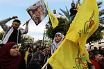 Palestinian supporters of the Fatah movement take part during a rally marking the fifty-four anniversary of the creation of the political party, in Gaza city on December 31, 2018. Photo by Ashraf Amra