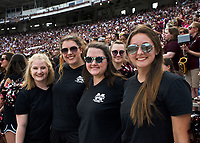 Members of the Famous Maroon Band pose for a photo during the Maroon and White football game. <br />  (photo by Lizzy Powers / &copy; Mississippi State University)