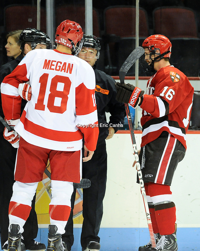 Boston University Terriers forward Wade Megan (18) and Saint Lawrence Saints forward Kyle Flanagan (16) chat before the start of the  Saint Lawrence vs Boston University NCAA hockey game played at the Agganis Arena, in Boston Massachusetts.  Eric Canha/CSM