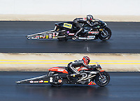 Sep 18, 2016; Concord, NC, USA; NHRA pro stock motorcycle rider Eddie Krawiec (near) races alongside Karen Stoffer during the Carolina Nationals at zMax Dragway. Mandatory Credit: Mark J. Rebilas-USA TODAY Sports