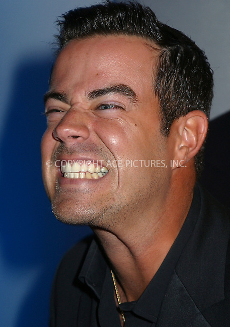 """He need to work on his cheesy smile""..TRL host Carson Daly arriving at ""GQ Men of the Year Awards"" in New York. October 16, 2002. Please byline: Alecsey Boldeskul/NY Photo Press.   ..*PAY-PER-USE*      ....NY Photo Press:  ..phone (646) 267-6913;   ..e-mail: info@nyphotopress.com"