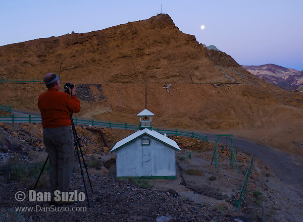 A photographer shoots the one-room schoolhouse at Ryan, California, a 1920s mining camp in the Greenwater Range on the Eastern edge of Death Valley