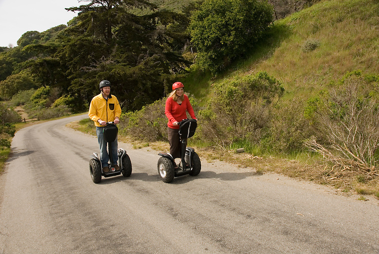 Couple on Segways, each on a Segway, on Angel Island State Park in San Francisco Bay, California, CA. Model released..Photo camari222-70432..Photo copyright Lee Foster, www.fostertravel.com, 510-549-2202, lee@fostertravel.com.