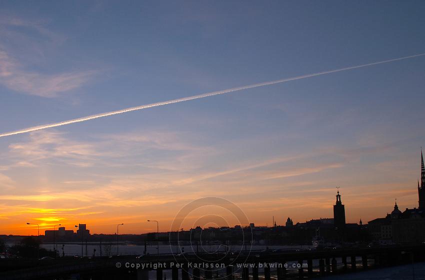 Sunset over Stockholm Slussen with a view over Riddarfjarden and Stadshuset the Town Hall. Stockholm, Sweden, Sverige, Europe