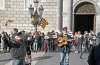 An unidentified man waves Catalonian flags, left, as a second unidentified man plays a guitar with the words &quot;Freedom for Catalunya&quot; written on it, right, on the street in front of the Palau de la Generalitat de Catalunya as they advocate for Catalonian independence from Spain on Tuesday, November 7, 2017. The building is a historic palace in Barcelona, Catalonia, that houses the offices of the Presidency of the Generalitat de Catalunya Barcelona. <br /> Credit: Ron Sachs / CNP /MediaPunch
