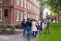A tour group walks past Massachusetts Hall in Harvard Yard at Harvard University in Cambridge, Massachusetts, USA, on Mon., Oct 15, 2018. Massachusetts Hall is a freshman dormitory at Harvard, is the oldest dorm in the United States, and also houses the office of Harvard's president.