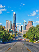 Austin is the home to the Capital of Texas which is located in downtown Austin in the city.  The city of Austin is a fairly large city with a population of around 843,000 but the Travis County area is over a million plus and growing.  So the city is constantly changing, cranes are everywhere and it will be years before we will see the new skyline but with the exception of the new Marriot and a few other building in this view is pretty much the same.  We decided to get a more recent shot of this photo with one looking up from South Congress back at the Texas State Capital.  It was a great day for a photographs with the blue skies and nice clouds the city skyline was able to be captured with all it beauty.  The last time we did this photograph the area was not so busy, however it was crazy with cars and people.  It is amazing how fast this city is growing and at time the traffic is so bad you don't want to come downtown anymore.  Its just the sign of the time as more and more pour into the city.  In the eighties the city counsel decided that it would be best to curb urban sprawl so they started pushing downtown living with the thought that it would create less traffic because people working downtown could walk to work however what has happened is they live downtown but work elsewhere so going into downtown or out of the city makes no difference for traffic anymore.