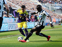 Pictured L-R: Pablo Hernanez of Swansea gets past Cheik Tiote of Newcastle. Saturday 19 April 2014<br /> Re: Barclay's Premier League, Newcastle United v Swansea City FC at St James Park, Newcastle, UK.