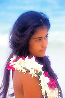 Young Polynesian woman with ginger, tuberose and orchid leis at beach
