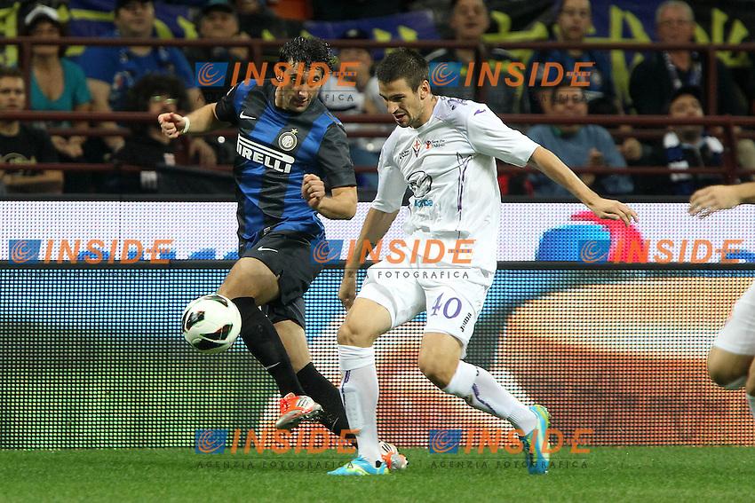 """Diego Milito Inter Nenad Tomovic Fiorentina.Milano 30/09/2012 Stadio """"San Siro"""".Football Calcio Serie A 2012/13.Inter v Fiorentina.Foto Insidefoto Paolo Nucci."""