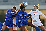 29 November 2013: Duke's Natasha Anasi (center) wins a header against Virginia Tech's Shannon Mayrose (right) and Duke's Kim DeCesare (19). The Virginia Tech University Hokies played the Duke University Blue Devils at Thompson Field in Blacksburg, Virginia in a 2013 NCAA Division I Women's Soccer Tournament Quarterfinal match. Virginia Tech won the game 3-0.