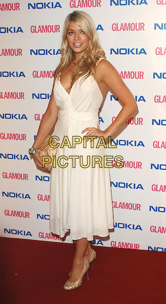 HOLLY WILLOUGHBY & FEARNE COTTON.The Glamour magazine 3rd Annual Women Of The Year Awards, Berkley Sqaure, London, England..June 6th, 2006.Ref: BEL.full length white dress shoes clutch purse hand on hip.www.capitalpictures.com.sales@capitalpictures.com.© Capital Pictures.