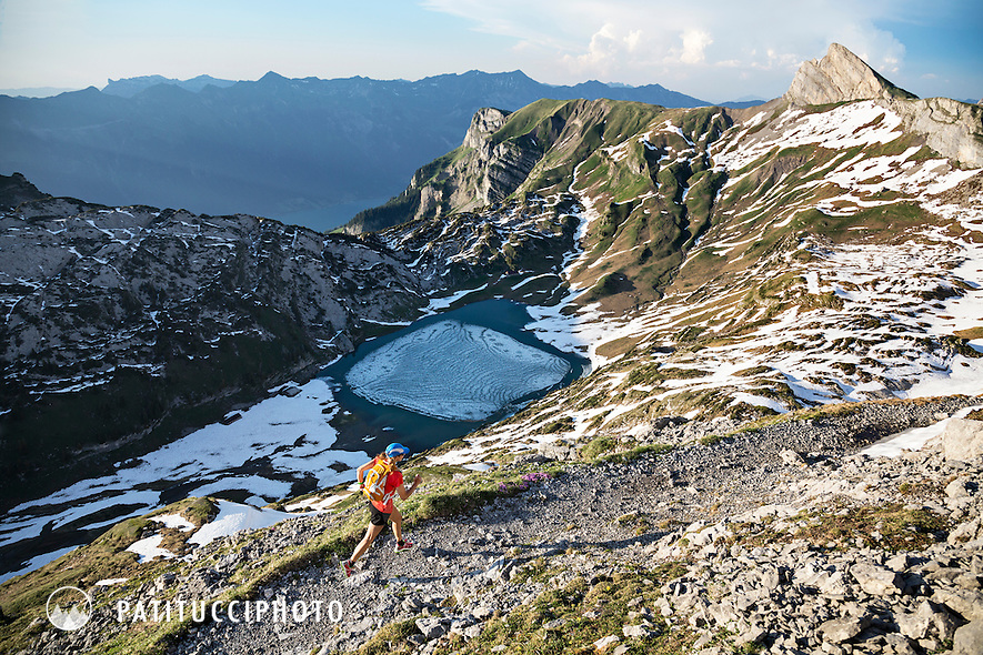 One woman trail running in the Swiss Alps on a trail to the Schynige Platte, in the Bernese Oberland. The same trail used in the Eiger Trail Race.