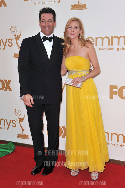 Jon Hamm & Jennifer Westfeldt arriving at the 2011 Primetime Emmy Awards at the Nokia Theatre, L.A. Live in downtown Los Angeles..September 18, 2011  Los Angeles, CA.Picture: Paul Smith / Featureflash