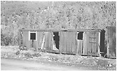 Old RGS section house car body just west of Rico engine house.<br /> RGS  Rico, CO  Taken by Maxwell, John W. - 6/27/1964
