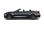 Car driver side profile view of a 2020 BMW 4 Series 430i 2 Door Convertible
