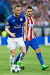 Jamie Vardy of Leicester City Football Club competes for the ball with Koke Resurrecccion of Atletico de Madrid during the match of  Champions LEague between  Atletico de Madrid and LEicester City Football Club at Vicente Calderon  Stadium  in Madrid, Spain. April 12, 2017. (ALTERPHOTOS / Rodrigo Jimenez)