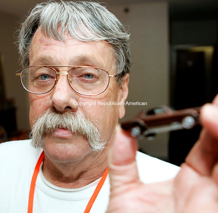 WATERBURY, CT - 30 JULY 2005 -073005JT05--<br /> Cookie Lind, of Norwalk, Cali., at the Hot Wheels Convention in the Connecticut Grand Hotel in Waterbury, holds up his favorite Hot Wheels car, a Chocolate Brown Cougar, which is so rare he has only ever seen one other of its kind in his life. He traded three cars for the Cougar three months ago at a convention in Ogden, Utah.<br /> --Josalee Thrift Photo--
