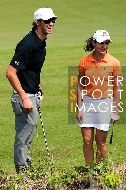 HAIKOU, CHINA - OCTOBER 30:  Lorena Ochoa (R) of Mexico and Michael Phelps of USA laugh on the 4th green during day four of the Mission Hills Start Trophy tournament at Mission Hills Resort on October 30, 2010 in Haikou, China. The Mission Hills Star Trophy is Asia's leading leisure liflestyle event and features Hollywood celebrities and international golf stars. Photo by Victor Fraile / The Power of Sport Images