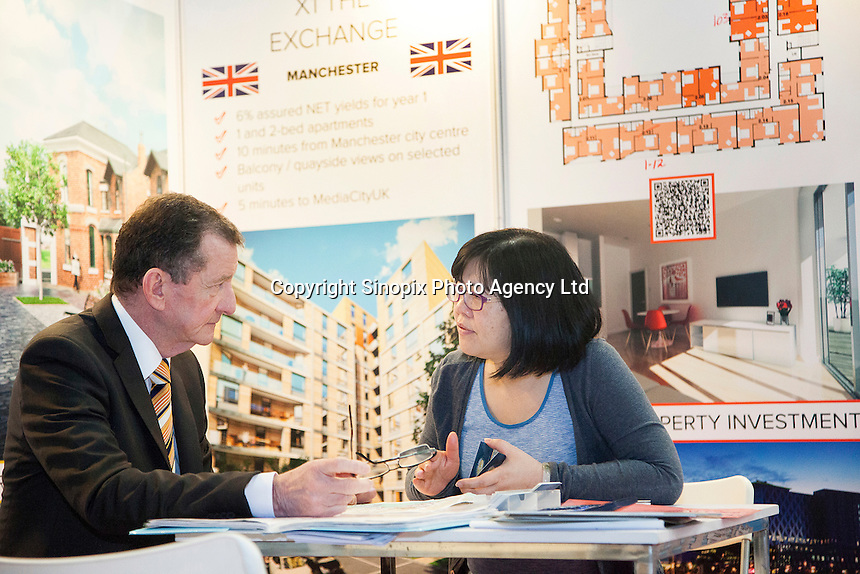 Alisdair Macdonald of Knight Knox International Ltd, speaks to Eva Leong, who bought a property after listening to Alisdair speak at the Smart International Property Investment Expo at the Hong Kong Convention and Exhibition Centre in Hong Kong. <br /> 07-08 June, 2014<br /> <br /> Photo by Tim O'Rourke / Sinopix