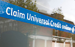Claim Universal Credit online banner in window of Jobcentre Plus office, Department for Work and Pensions, Devizes, Wiltshire, England, UK