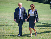 United States President Donald J. Trump and first lady Melania Trump holds hands as they arrive back at the White House in Washington, DC after a trip to Joint Base Andrews to pay their respects to the family of fallen United States Secret Service Special Agent Nole Edward Remagen who suffered a stroke while on duty in Scotland on Wednesday, July 18, 2018.<br /> Credit: Ron Sachs / CNP