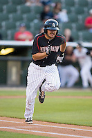 Christian Stringer (9) of the Kannapolis Intimidators hustles down the first base line against the Greenville Drive at CMC-Northeast Stadium on April 28, 2015 in Kannapolis, North Carolina.  The Intimidators defeated the drive 3-2.  (Brian Westerholt/Four Seam Images)