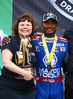 Apr 27, 2014; Baytown, TX, USA; NHRA top fuel dragster driver Antron Brown celebrates with crew after winning the Spring Nationals at Royal Purple Raceway. Mandatory Credit: Mark J. Rebilas-