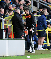 Blackpool's Mark Howard, on crutches after suffering an injury in the first half, takes a seat in the dug-out at the start of the second half<br /> <br /> Photographer Chris Vaughan/CameraSport<br /> <br /> The EFL Sky Bet League One - Burton Albion v Blackpool - Saturday 16th March 2019 - Pirelli Stadium - Burton upon Trent<br /> <br /> World Copyright &copy; 2019 CameraSport. All rights reserved. 43 Linden Ave. Countesthorpe. Leicester. England. LE8 5PG - Tel: +44 (0) 116 277 4147 - admin@camerasport.com - www.camerasport.com
