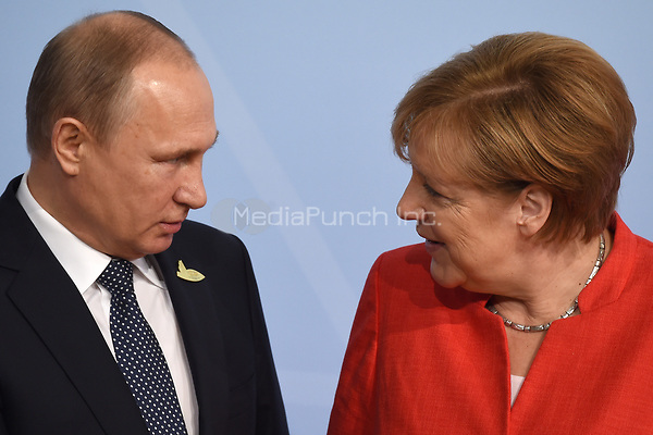 German chancellor Angela Merkel greets the Russian president Vladimir Putin at the G20 summit in Hamburg, Germany, 7 July 2017. The heads of the governments of the G20 group of countries are meeting in Hamburg on the 7-8 July 2017. Photo: Carsten Rehder/dpa /MediaPunch ***FOR USA ONLY***