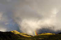 Thunderstorm clouds and rainbow over Yellowstone River Valley in southern Montana.  May.