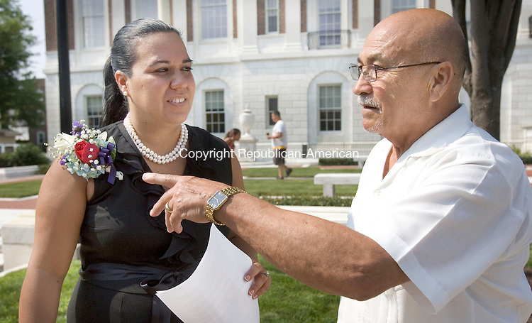 WATERBURY CT. 24 July 2014-072514SV01-From left, Puerto Rican Mayor for the Day, Maritza Acosta-Gay of  Waterbury with father, Aldelberto Acosta of Waterbury, the first Puerto Rican Mayor for the Day, at the ceremony in front of  City Hall in Waterbury Friday. <br /> Steven Valenti Republican-American