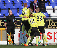 St Mirren players congratulate Jason Naismith for his cross for the opening goal in the Inverness Caledonian Thistle v St Mirren Scottish Professional Football League Premiership match played at the Tulloch Caledonian Stadium, Inverness on 29.3.14.