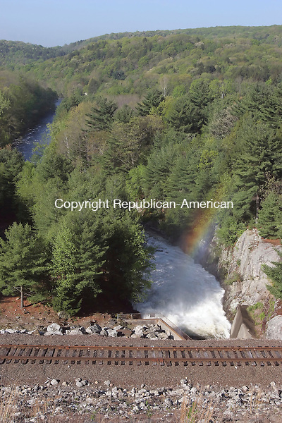 THOMASTON, CT-18 May 2006-051806TK03- A controlled strong flow of water continues to discharge from the base of the Thomaston Dam as accumulated water levels in the dam site subside.  Tom Kabelka Republican-American (Thomaston Dam)