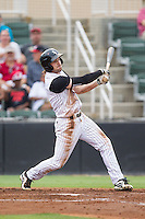 Hunter Jones (1) of the Kannapolis Intimidators follows through on his swing against the Savannah Sand Gnats at CMC-Northeast Stadium on June 9, 2014 in Kannapolis, North Carolina.  The Intimidators defeated the Sand Gnats 4-2.  (Brian Westerholt/Four Seam Images)