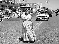 Performance artist Suzanne Muldowney marches during the Independence Parade Saturday July 2, 2016 on Beach Avenue in Cape May, New Jersey. Photo by William Thomas Cain/Cain Images