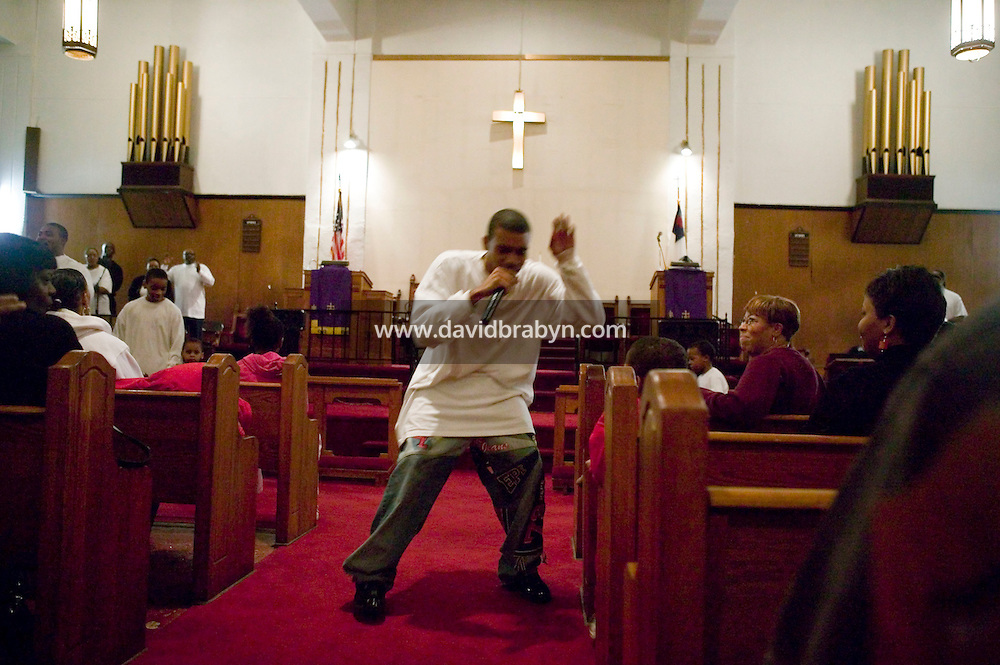 New York, USA - Donovan  Bratton (C), 16, raps during mass at the Greater Hood Memorial AME Zion Church, home of the Hip-Hop Church, in Harlem, New York, USA, 24 February 2005. Photo Credit: David Brabyn.
