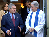 U.S. President George W. Bush (L) talks to Reverend Louis Leon after attending Sunday morning service at St. John's Episcopal Church, in Washington on December 10, 2006. (UPI Photo/Kevin Dietsch