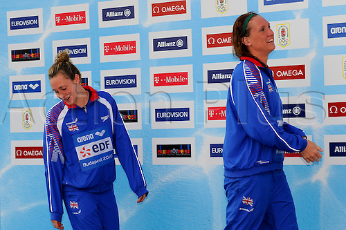 12.8.2010 Budpest, Hungary. 2010 LEN European Championships, (L-R) Elizabeth Simmonds (GBR), Gemma Spofforth (GBR) walk onto the podium for the Womens 100m Backstroke to collect their Silver and Gold medals (respectively)