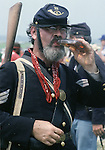 Union Soldier, Sgt. Bill Calloway, a full time veterinarian, drinks brandy from a glass bottle before the Civil War re-enactment for the the Battle of Fort Morgan, Mobile, Al in 2001. Calloway, a veteran of eight years of re-enactments has fought battler from Gettysburg to the Battle of Mobile Bay. Jim Bryant Photo. @2001. All Rights Reserved.