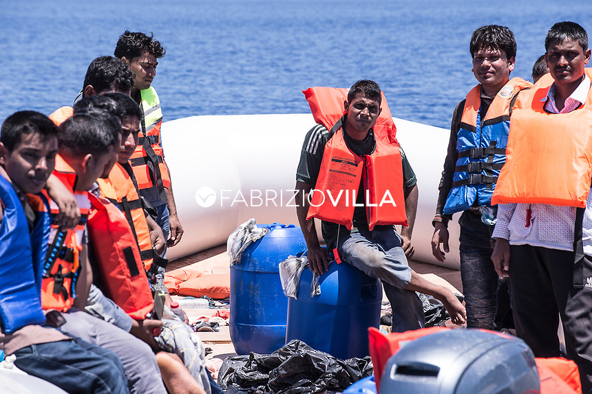 Rescue operation of the Italian Navy in the Mediterranean Sea at 20 miles of the coasts of Libya. The crew of the ship Carlo Margottini rescue has an inflatable dinghy with 121 migrants coming from Libya. 120 men and 1 pregnant woman. Bengalis and Africans.