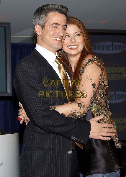 DERMOT MULRONEY & DEBRA MESSING.10th Annual Moviefone Moviegoer Awards Nominations held at The Regent Beverly Wilshire Hotel, Beverly Hills, California.January 20th, 2005.Photo Credit: Jacqui Wong/AdMedia.half length, green sheer sleeves, hug, embrace, gesture.www.capitalpictures.com.sales@capitalpictures.com.© Capital Pictures.