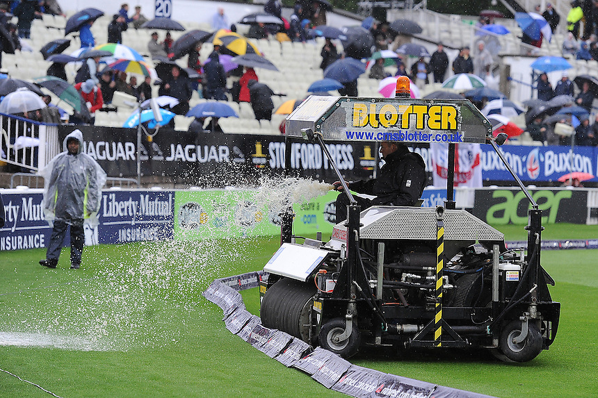 Groundsmen work on the Edgbaston wicket during a rain shower<br /> <br /> Photo by Stephen White/CameraSport<br /> <br /> International Cricket - NatWest Series - 3rd ODI -  England v Australia - Wednesday 11th September 2013 - Edgbaston, Birmingham<br /> <br /> &copy; CameraSport - 43 Linden Ave. Countesthorpe. Leicester. England. LE8 5PG - Tel: +44 (0) 116 277 4147 - admin@camerasport.com - www.camerasport.com