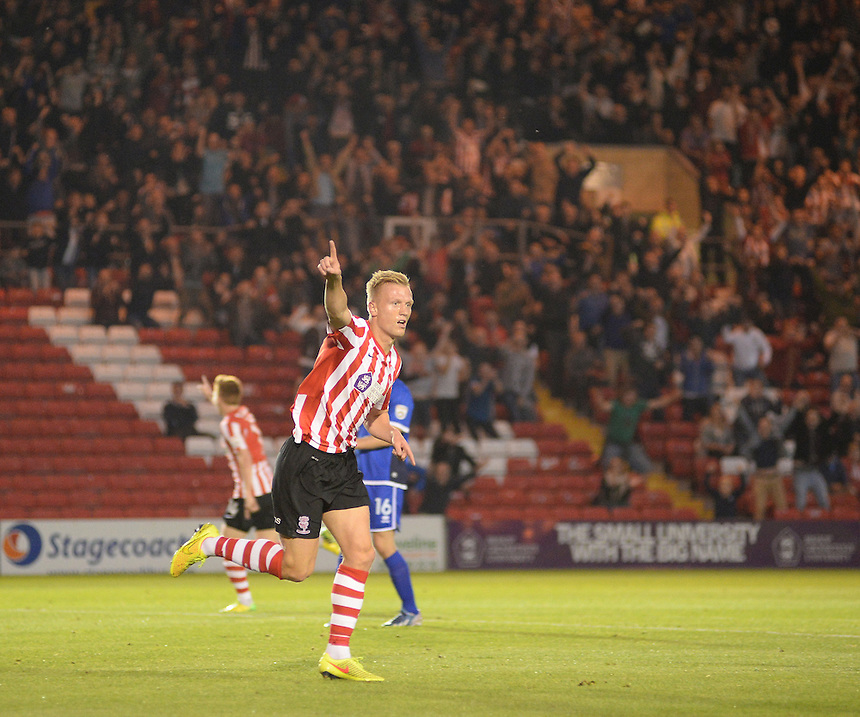 Lincoln City's Jordan Burrow celebrates scoring the opening goal <br /> <br /> Photo by Chris Vaughan/CameraSport<br /> <br /> Football - English Football Vanarama Conference Premier League - Lincoln City v Grimsby Town - Tuesdayb9th September 2014 - Sincil Bank - Lincoln<br /> <br /> &copy; CameraSport - 43 Linden Ave. Countesthorpe. Leicester. England. LE8 5PG - Tel: +44 (0) 116 277 4147 - admin@camerasport.com - www.camerasport.com