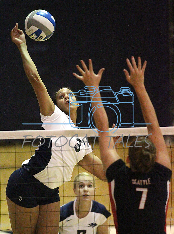 Nevada's Janelle Batista goes up for a kill against Seattle University's Cristin Richards during NCAA women's college volleyball in Reno, Nev., on Thursday, Oct. 20, 2011. Nevada won 3-0..Photo by Cathleen Allison