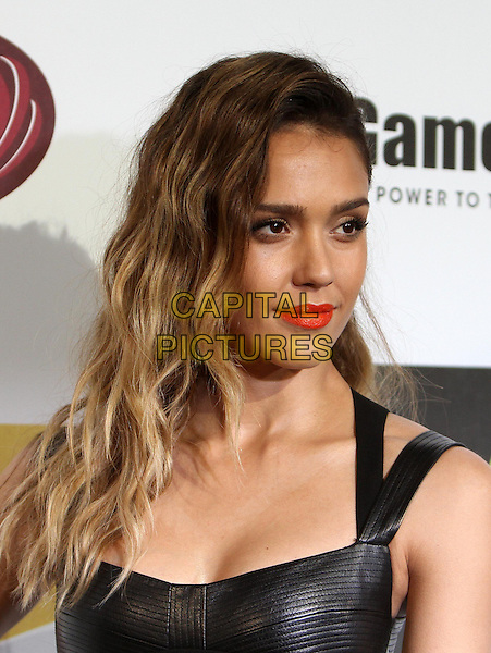 Jessica Alba.Spike TV's 10th Annual Video Game Awardse Held at Sony Pictures Studios,  Culver City, California, USA, .7th December 2012..portrait headshot  red orange lipstick make-up  beauty eyelashes wavy hair black  leather.CAP/ADM/KB.©Kevan Brooks/AdMedia/Capital Pictures.