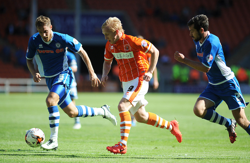 Blackpool's Mark Cullen under pressure from Rochdale's Oliver Lancashire (left) and Joe Rafferty<br /> <br /> Photographer Kevin Barnes/CameraSport<br /> <br /> Football - The Football League Sky Bet League One - Blackpool v Rochdale - Saturday 15th August 2015 - Bloomfield Road - Blackpool<br /> <br /> &copy; CameraSport - 43 Linden Ave. Countesthorpe. Leicester. England. LE8 5PG - Tel: +44 (0) 116 277 4147 - admin@camerasport.com - www.camerasport.com